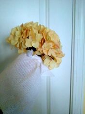 Hold a paper towel or rag under the petals to avoid spraying the green stem.
